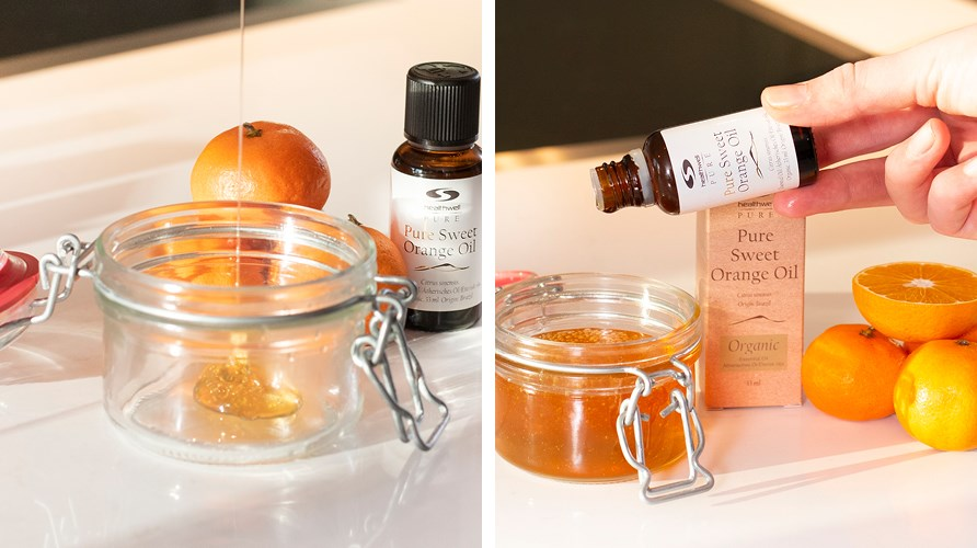 Pure Orange Oil ECO is poured into a jar of honey.